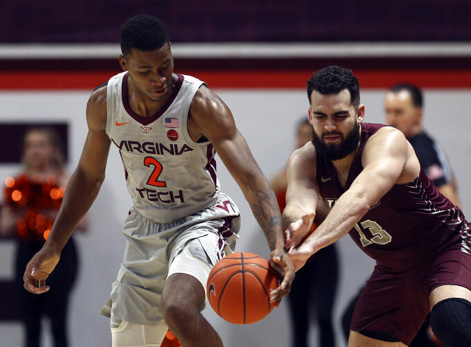Virginia Tech's Landers Nolley II (2) has the ball tipped from behind by Maryland-Eastern Shore's Bryan Urrutia (13) in the first half of an NCAA college basketball game in Blacksburg, Va., Sunday, Dec. 29 2019. (Matt Gentry/The Roanoke Times via AP)