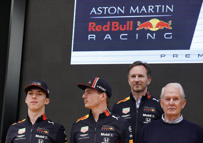 From left, Formula One Red Bull drivers Pierre Gasly of France and Max Verstappen of the Netherlands, Red Bull team manager Christian Horner, and Red Bull sports director Helmut Marko pose for photographers during a Honda F1 promotional event Saturday, March 9, 2019, in Tokyo. (AP Photo/Eugene Hoshiko)