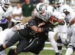 Colorado State quarterback Collin Hill, right, is sacked by Air Force defensive lineman Livingston Paogofie, left, and linebacker Tanner Clem in the first half of an NCAA college football game Thursday, Nov. 22, 2018, at Air Force Academy, Colo. (AP Photo/David Zalubowski)