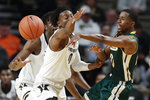Southeastern Louisiana guard Von Julien, right, passes the ball past Vanderbilt guard Saben Lee (0) in the first half of an NCAA college basketball game Monday, Nov. 25, 2019, in Nashville, Tenn. (AP Photo/Mark Humphrey)