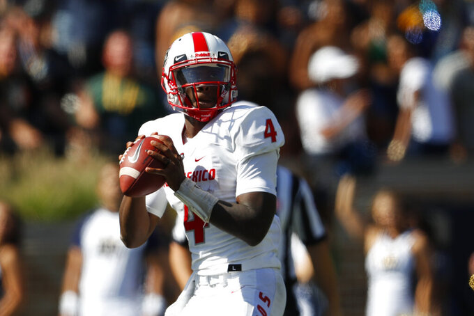 New Mexico quarterback Sheriron Jones (4) passes against Notre Dame in the first half of an NCAA college football game in South Bend, Ind., Saturday, Sept. 14, 2019. (AP Photo/Paul Sancya)