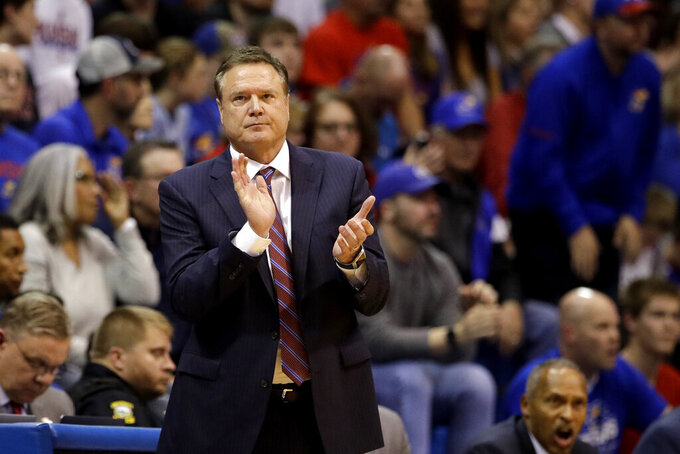 Kansas head coach Bill Self watches during the second half of an NCAA college basketball game against East Tennessee State Tuesday, Nov. 19, 2019, in Lawrence, Kan. Kansas won 75-63. (AP Photo/Charlie Riedel)