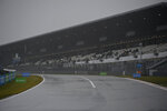 Overcast weather delays the start of the first practice session for the Eifel Formula One Grand Prix at the Nuerburgring racetrack in Nuerburg, Germany, Friday, Oct. 9, 2020. The Germany F1 Grand Prix will be held on Sunday. (Ina Fassbender, Pool via AP)