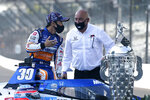 Takuma Sato, left, of Japan, winner of the 2020 Indianapolis 500 auto race, talks with Bobby Rahal during the traditional winners photo session at the Indianapolis Motor Speedway, Monday, Aug. 24, 2020, in Indianapolis. (AP Photo/Darron Cummings)