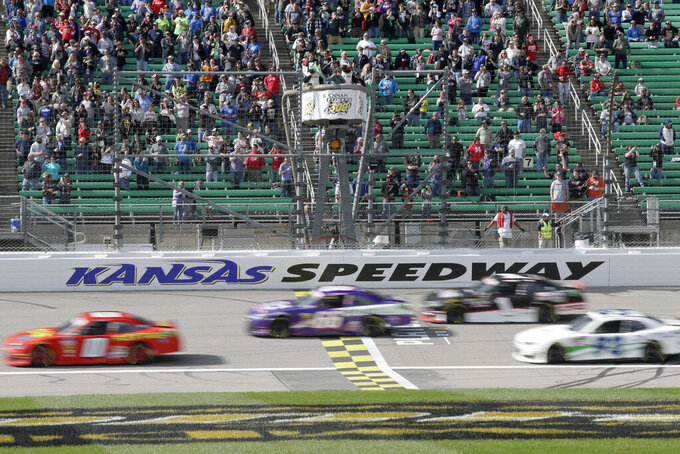 NASCAR Xfinity drivers take the green flag during an NASCAR Xfinity Series auto race at Kansas Speedway in Kansas City, Kan., Saturday, Oct. 19, 2019. (AP Photo/Orlin Wagner)