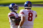 New York Giants running back Wayne Gallman (22) and quarterback Daniel Jones (8) celebrate after Gallman scored a touchdown against Washington Football Team in the first half of an NFL football game, Sunday, Nov. 8, 2020, in Landover, Md. (AP Photo/Patrick Semansky)