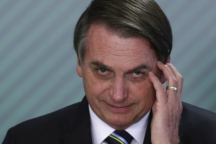 FILE - In this April 9, 2019 file photo, Brazil's President Jair Bolsonaro speaks during a swearing-in ceremony at the Planalto Presidential Palace, in Brasilia, Brazil. Bolsonaro's latest education minister offered his resignation Tuesday, June 30, 2020, just days after his appointment, creating a new headache for the embattled leader as he struggles to start a new chapter at the ministry and shore up flagging support. (AP Photo/Eraldo Peres, File)