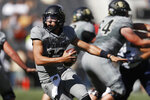 Colorado quarterback Steven Montez scrambles away from New Hampshire defenders in the first half of an NCAA college football game Saturday, Sept. 15, 2018, in Boulder, Colo. (AP Photo/David Zalubowski)
