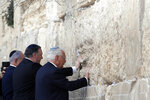 Israeli Prime Minister Benjamin Netanyahu, U.S. Secretary of State Mike Pompeo and U.S. Ambassador to Israel David Friedman touch the stones of the Western Wall during a visit to the site in Jerusalem's Old City, Thursday, March 21, 2019. (Jim Young/Pool Image via AP)