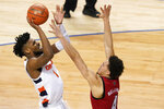 Syracuse forward Quincy Guerrier (1) takes a shot over North Carolina State forward Jericole Hellems (4) during the second half of an NCAA college basketball game in the second round of the Atlantic Coast Conference tournament in Greensboro, N.C., Wednesday, March 10, 2021. (AP Photo/Gerry Broome)