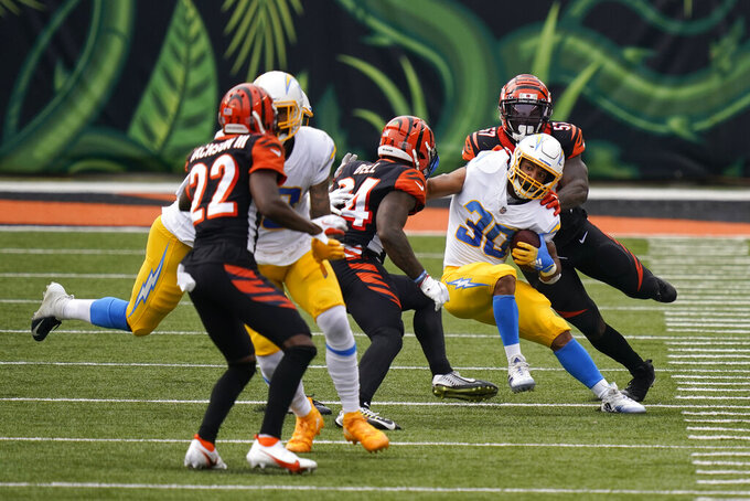 Los Angeles Chargers running back Austin Ekeler (30) is tackled by Cincinnati Bengals linebacker Germaine Pratt (57) during the first half of an NFL football game, Sunday, Sept. 13, 2020, in Cincinnati. (AP Photo/Bryan Woolston)