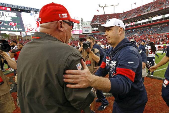 Houston Texans head coach Bill O'Brien, right, shakes hands with Tampa Bay Buccaneers head coach Bruce Arians after an NFL football game Saturday, Dec. 21, 2019, in Tampa, Fla. (AP Photo/Mark LoMoglio)