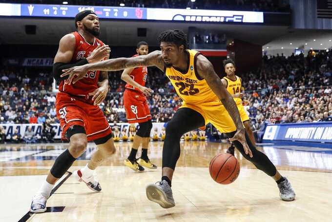 Arizona State's Romello White (23) drives against St. John's Marvin Clark II (13) during the first half of a First Four game of the NCAA men's college basketball tournament Wednesday, March 20, 2019, in Dayton, Ohio. (AP Photo/John Minchillo)