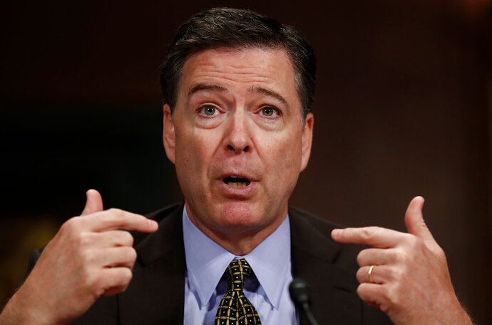 FILE - In this May 3, 2017, file photo, then-FBI Director James Comey testifies on Capitol Hill in Washington. Comey is blasting President Donald Trump as unethical and