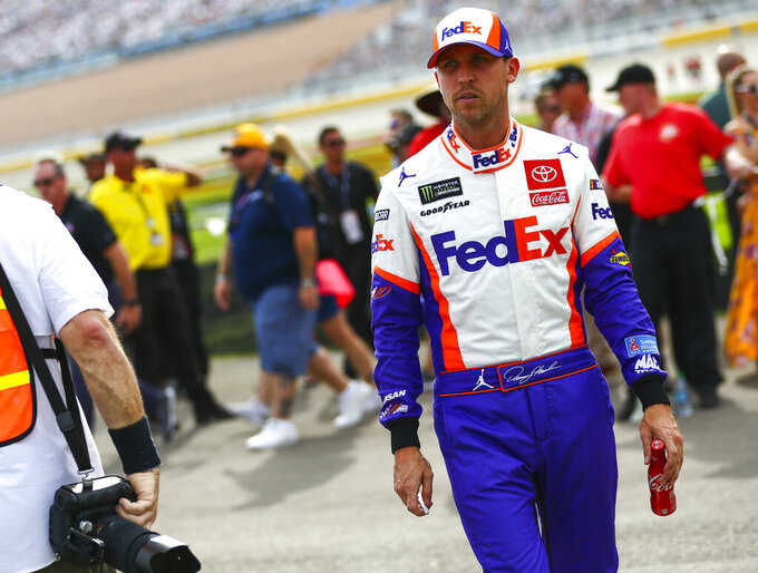 Denny Hamlin heads to his car before a NASCAR Cup Series auto race at the Las Vegas Motor Speedway on Sunday, Sept. 15, 2019. (AP Photo/Chase Stevens)