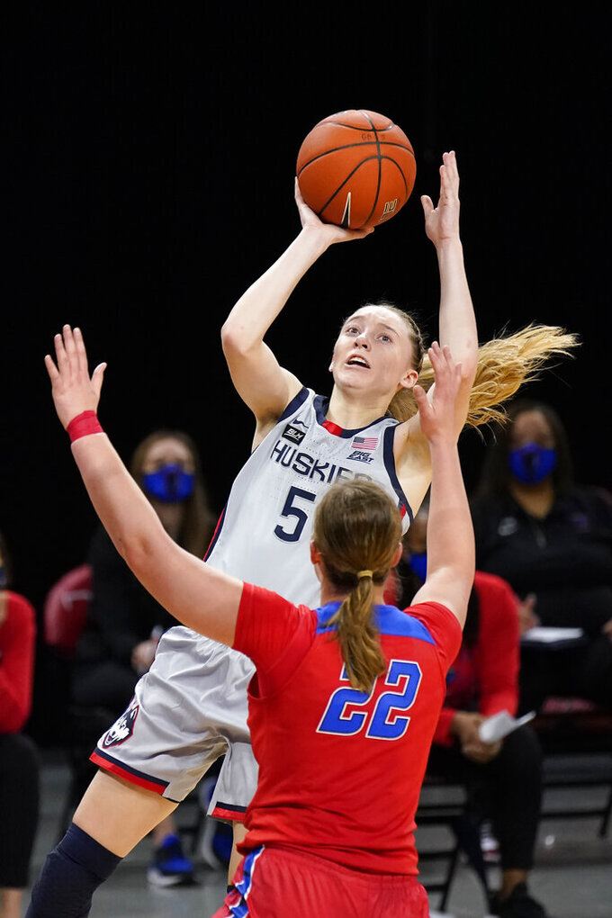 FILE - Connecticut's Paige Bueckers (5) shoots over DePaul's Jorie Allen during the first half of an NCAA college basketball game in Chicago, in this Sunday, Jan. 31, 2021, file photo. Bueckers has made The Associated Press All-America first team, announced Wednesday, March 17, 2021. (AP Photo/Charles Rex Arbogast, File)