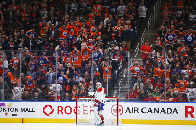 Montreal Canadiens goalie Carey Price stands in front of the net as Edmonton Oilers fans cheer a goal during the third period of an NHL hockey game Saturday, Dec. 21, 2019, in Edmonton, Alberta. (Jeff McIntosh/The Canadian Press via AP)