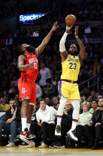 Los Angeles Lakers' LeBron James (23) shoots over Houston Rockets' James Harden during the first half of an NBA basketball game Thursday, Feb. 21, 2019, in Los Angeles. (AP Photo/Marcio Jose Sanchez)