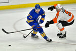 Buffalo Sabres center Curtis Lazar (27) is defended by Philadelphia Flyers defenseman Philippe Myers (5) during the third period of an NHL hockey game in Buffalo, N.Y., Monday, March 29, 2021. (AP Photo/Adrian Kraus)
