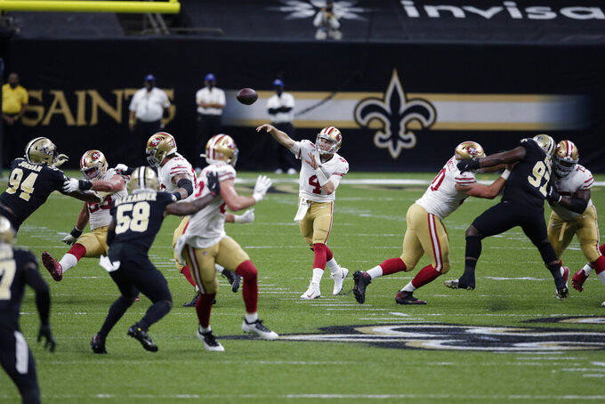San Francisco 49ers quarterback Nick Mullens (4) passes from the pocket in the first half of an NFL football game against the New Orleans Saints in New Orleans, Sunday, Nov. 15, 2020. (AP Photo/Butch Dill)