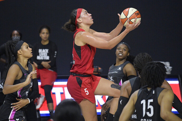 Las Vegas Aces forward Dearica Hamby goes up for a shot during the first half of the team's WNBA basketball game against the Dallas Wings, Tuesday, Aug. 25, 2020, in Bradenton, Fla. (AP Photo/Phelan M. Ebenhack)