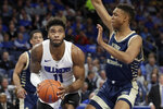 Saint Louis' Hasahn French, left, looks to the basket as George Washington's Ace Stallings defends during the second half of an NCAA college basketball game Wednesday, Jan. 8, 2020, in St. Louis. (AP Photo/Jeff Roberson)
