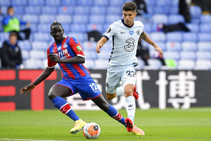 FILE - In this Tuesday, July 7, 2020 file photo, Crystal Palace's Mamadou Sakho, left, and Chelsea's Christian Pulisic in action during the English Premier League soccer match between Crystal Palace and Burnley at Selhurst Park, in London, England. Center-back Mamadou Sakho signed with French club Montpellier on Tuesday July 27, 2021, after playing eight seasons in the Premier League. (Justin Tallis/Pool via AP, File)