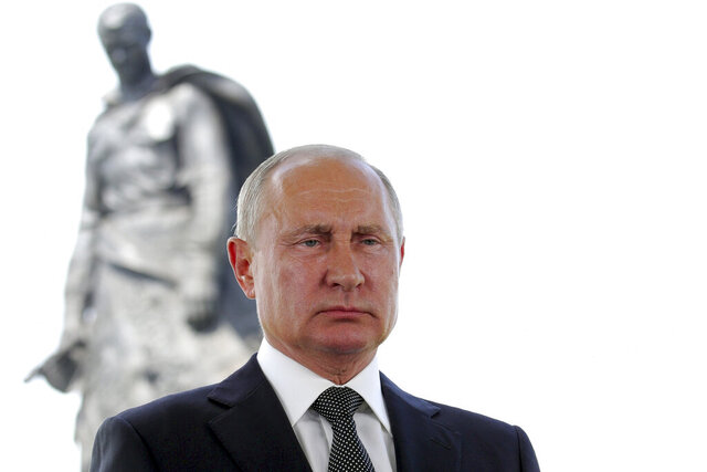 Russian President Vladimir Putin appears in a televised address to the nation in Khoroshevo, the Tver region, with a monument to World War II Red Army soldiers seen in the background, Russia, Tuesday, June 30, 2020. Putin urged voters to cast ballots in a constitutional vote wrapping up Wednesday that could allow him to extend his rule until 2036. (Mikhail Klimentyev, Sputnik, Kremlin Pool Photo via AP)