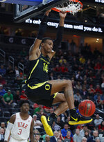 Oregon's Kenny Wooten dunks against Utah during the second half of an NCAA college basketball game in the quarterfinals of the Pac-12 men's tournament Thursday, March 14, 2019, in Las Vegas. (AP Photo/John Locher)