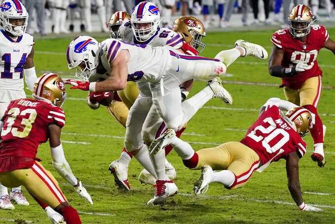 Buffalo Bills tight end Dawson Knox (88) is hit by San Francisco 49ers free safety Jimmie Ward (20) during the second half of an NFL football game, Monday, Dec. 7, 2020, in Glendale, Ariz. (AP Photo/Ross D. Franklin)