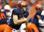 FILE - In this Nov. 9, 2018, file photo, Syracuse quarterback Eric Dungey runs with the ball during the first half of an NCAA college football game against Louisville in Syracuse, N.Y.  Third-ranked Notre Dame will put its unbeaten record on the line when it faces No. 12 Syracuse at New York's Yankee Stadium on Saturday.  (AP Photo/Adrian Kraus, File)