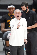 Arizona State head coach Bobby Hurley shouts to his team in the first half during an NCAA college basketball game against Utah Saturday, March 6, 2021, in Salt Lake City. (AP Photo/Rick Bowmer)