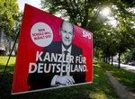 """An election poster shows Social Democratic top candidate for chancellor Olaf Scholz in Frankfurt, Germany, Monday, Sept. 13, 2021. German elections will be on Sept.26. Letters read """"Chancellor for Germany - Whoever wants Scholz votes the SPD"""". (AP Photo/Michael Probst)"""