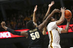 Minnesota's forward Jordan Murphy goes up to the basket against Purdue's Trevion Williams during the first half of an NCAA basketball game Tuesday, March 5, 2019, in Minneapolis. (AP Photo/Stacy Bengs)