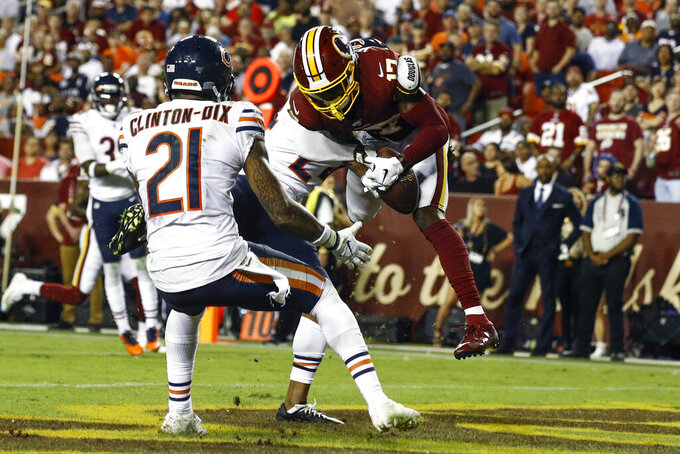 Chicago Bears strong safety Ha Ha Clinton-Dix (21) and Chicago Bears cornerback Buster Skrine (24) cannot stop a touchdown catch by Washington Redskins wide receiver Terry McLaurin (17) during the second half of an NFL football game Monday, Sept. 23, 2019, in Landover, Md. (AP Photo/Patrick Semansky)