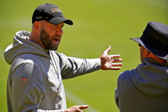 Pittsburgh Steelers quarterback Ben Roethlisberger, left, talks with offensive coordinator Matt Canada during the team's NFL minicamp football practice in Pittsburgh, Thursday, June 17, 2021. (AP Photo/Gene J. Puskar)