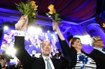Chairman of The Finns Party Jussi Halla-aho, left, Party Secretary Riikka Slunga-Poutsalo and Campaign manager Ossi Sandvik, right, attend The Finns Party parliamentary election party in Helsinki, Finland on Sunday, April 14, 2019. (Vesa Moilanen/Lehtikuva via AP)