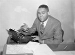 """FILE - Richard Wright, author of """"Native Son,"""" appears in New York on March 21, 1945. More than 60 years after his death, Wright's short novel, """"The Man Who Lived Underground,"""" was released April 20, 2021, by the Library of America. (AP Photo/Robert Kradin, File)"""