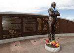 Bouquets of flowers sit on the base of a statue of Denver Broncos owner Pat Bowlen outside Mile High Stadium, the home of the franchise, Friday, June 14, 2019, in Denver. Bowlen died Thursday night. (AP Photo/David Zalubowski)