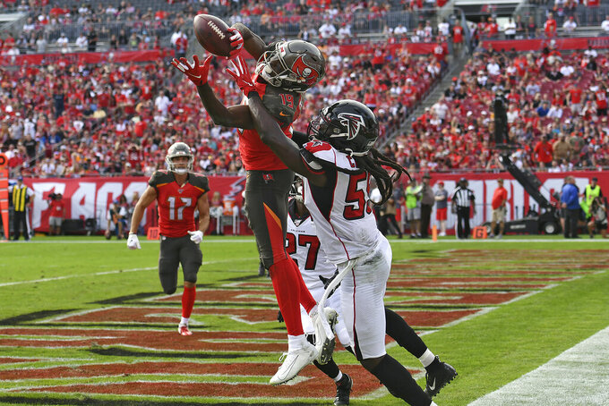 Tampa Bay Buccaneers wide receiver Breshad Perriman (19) pulls in a 24-yard touchdown reception in front of Atlanta Falcons outside linebacker De'Vondre Campbell (59) during the first half of an NFL football game Sunday, Dec. 29, 2019, in Tampa, Fla. (AP Photo/Jason Behnken)