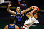 Duke guard Jordan Goldwire (14) fouls Miami guard Isaiah Wong (2) as he drives to the basket, during the second half of an NCAA college basketball game, Monday, Feb. 1, 2021, in Coral Gables, Fla. (AP Photo/Marta Lavandier)