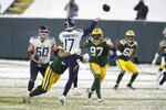 Tennessee Titans' Ryan Tannehill thorws under pressure during the second half of an NFL football game against the Green Bay Packers Sunday, Dec. 27, 2020, in Green Bay, Wis. (AP Photo/Matt Ludtke)