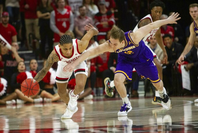 North Carolina State's Blake Harris (55) steals the ball from Lipscomb's Matt Rose (12) during the first half of an NCAA college basketball game in the quarterfinals of the NIT on Wednesday, March 27, 2019, in Raleigh, N.C. (Travis Long/The News & Observer via AP)