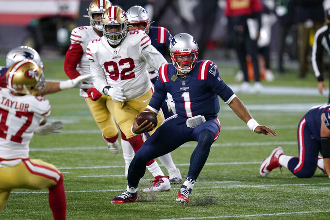 New England Patriots quarterback Cam Newton (1) scrambles away from San Francisco 49ers defenders Jamar Taylor, left, and Kerry Hyder Jr. (92) in the second half of an NFL football game, Sunday, Oct. 25, 2020, in Foxborough, Mass. (AP Photo/Charles Krupa)