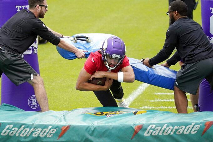 Minnesota Vikings rookie quarterback Kellen Mond goes through a drill during NFL football practice in Eagan, Minn., Wednesday, June 2, 2021.(AP Photo/Jim Mone)