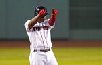 Boston Red Sox's Rafael Devers celebrates after his three-run double off Baltimore Orioles pitcher Branden Kline during the third inning of a baseball game in Boston, Wednesday, Sept. 23, 2020, at Fenway Park. (AP Photo/Charles Krupa)