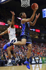 Duke forward Wendell Moore Jr. (0) shoots as Virginia guard Tomas Woldetensae (53) defends during an NCAA college basketball game Saturday, Feb. 29, 2020, in Charlottesville, Va. (AP Photo/Andrew Shurtleff)