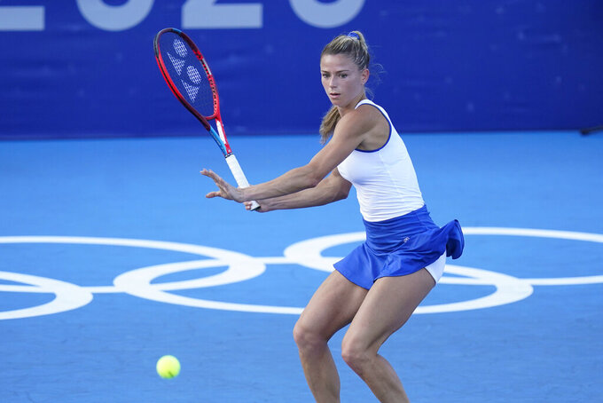 Camila Giorgi, of Italy, returns to Karolina Pliskova, of the Czech Republic, during the third round of the women's tennis competition at the 2020 Summer Olympics, Tuesday, July 27, 2021, in Tokyo, Japan. (AP Photo/Patrick Semansky)