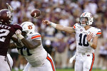 Auburn quarterback Bo Nix (10) passes down field against Texas A&M during the second half of an NCAA college football game, Saturday, Sept. 21, 2019, in College Station, Texas. (AP Photo/Sam Craft)