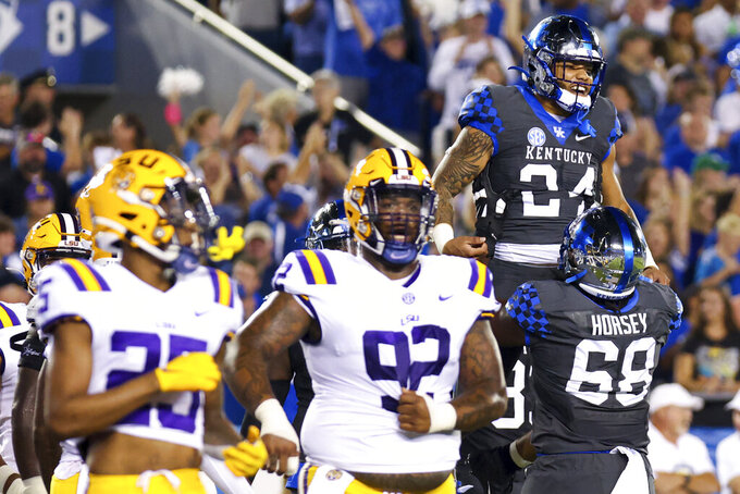 Kentucky running back Chris Rodriguez Jr. (24) celebrates his touchdown during the first half of the team's NCAA college football game against LSU in Lexington, Ky., Saturday, Oct. 9, 2021. (AP Photo/Michael Clubb)